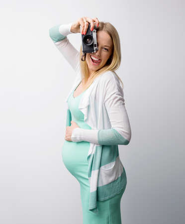 funny image: Funny pregnant woman taking pictures