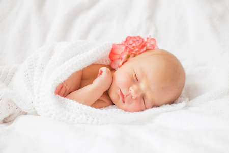 babies hands: Baby tugged in white blanket