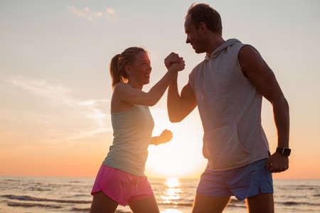 success man: Couple shaking hands workout