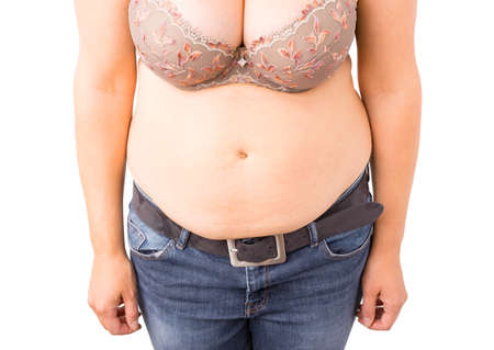 women in jeans: Woman with fat tummy Stock Photo