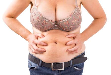 alzando la mano: Mujer con la grasa del vientre