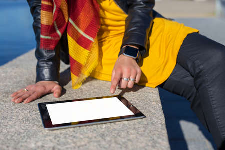 blank tablet: Person using blank screen tablet Stock Photo