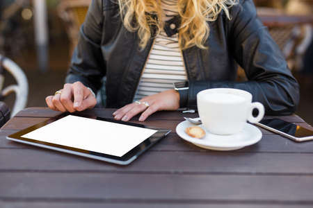 blank tablet: Woman using blank screen tablet Stock Photo