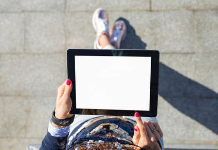 blank tablet: woman standing with blank screen tablet