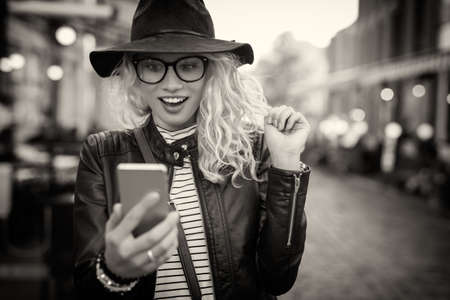 Black and white picture of woman looking at her phone