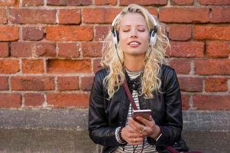 Woman enjoying music on her smartphone