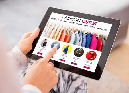 Fashion outlet website on tablet Stock Photo