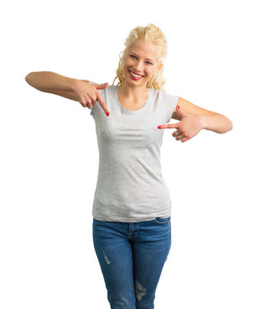 blank photo: Woman in grey round neck T-shirt pointing at it with both hands