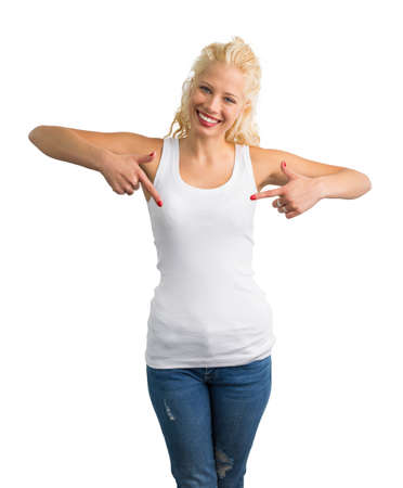 Woman in white tank-top pointing at it with both hands