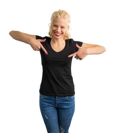 both: Woman in black V-neck T-shirt pointing at it with both hands