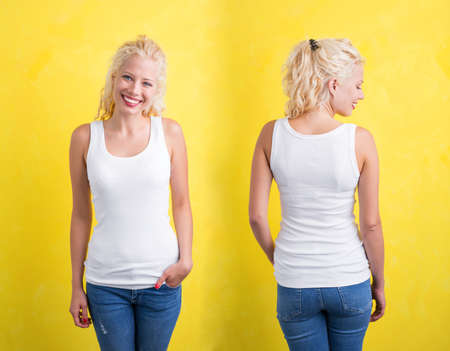tank: Woman in white tank top on yellow background Stock Photo