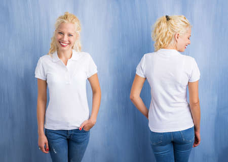 backside: Woman in white polo T-shirt on blue background Stock Photo