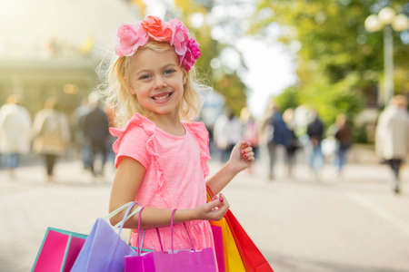 little fashionista holding shopping bags