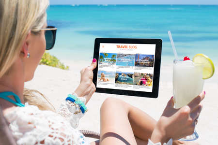 blogger: Woman reading travel blog on tablet