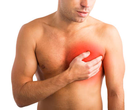heart pain: Man holding his hand to his chest and having heart pain