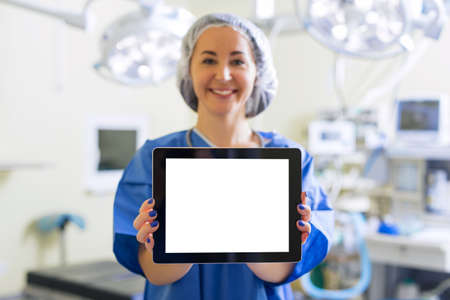 blank tablet: Doctor holding blank screen tablet
