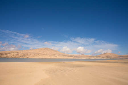Picture of desert with water basin