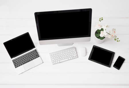 pedantic: Different modern gadgets on desk, view from above
