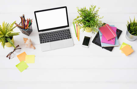 Creative person's desk from above in marketing agency Foto de archivo