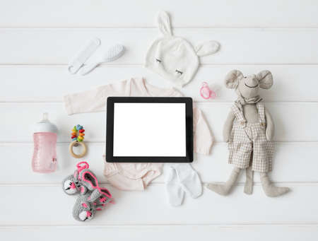 Tablet computer and babys items Reklamní fotografie
