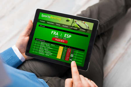 Man using sports betting app Stok Fotoğraf
