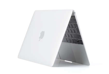 the latest models: RIGA, LATVIA - December 29, 2016: 12-inch Macbook laptop computer isolated on white.