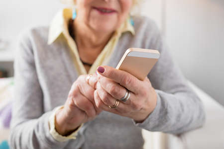 modern generation: Senior woman holding smartphone
