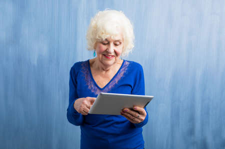 learning computer: Grandma learning how to use tablet computer Stock Photo