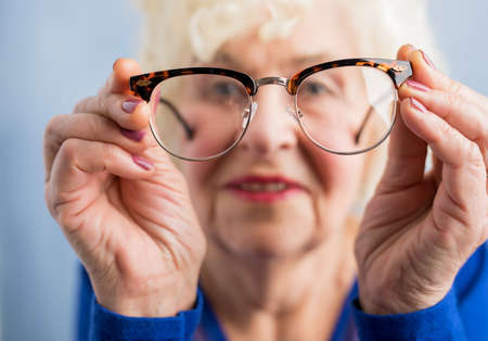 Grandma looking through her glasses