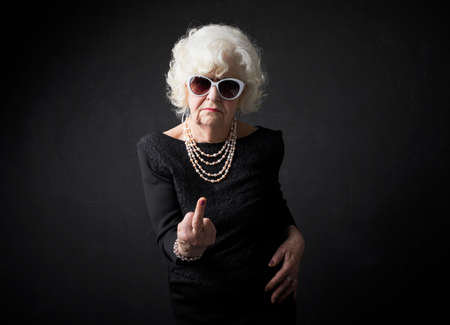 Grandmother flipping people off
