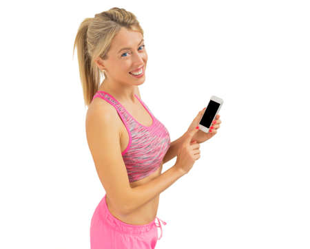 Active woman using smartphone during workout photo