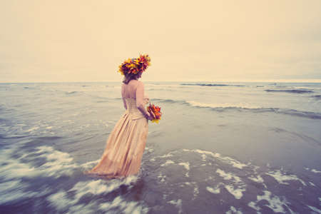 free image: Woman walking into water in autumn