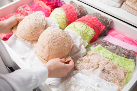 Woman organizing underwear in drawer Banque d'images