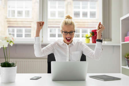 office person celebrating success 스톡 콘텐츠