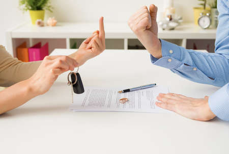 Woman and man going through ugly divorce Stock Photo