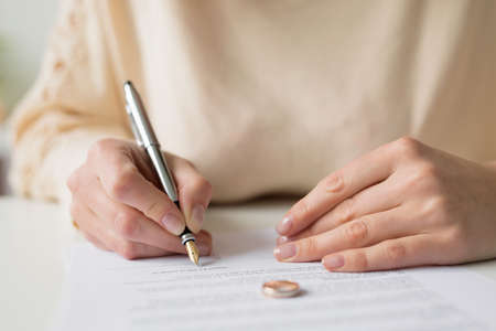Woman signing divorce papers
