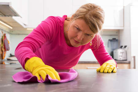 Person cleaning the hard stains from counter Stock Photo