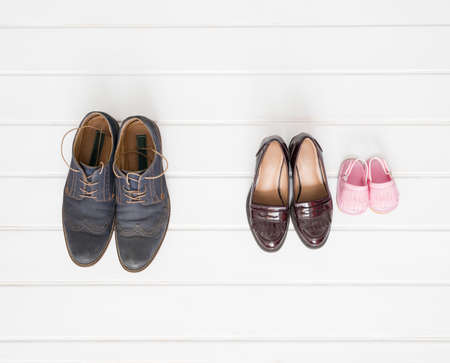 seperated: Males, females and children shoes setup on white background Stock Photo
