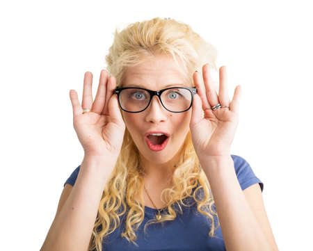 Woman with new optical glasses on showing her surprise