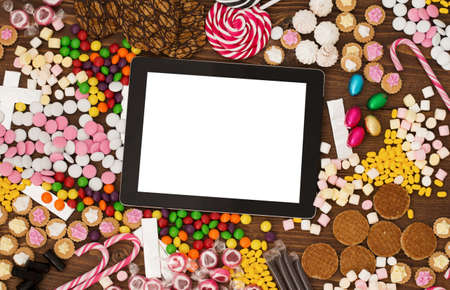 Tablet computer and candy Stock Photo