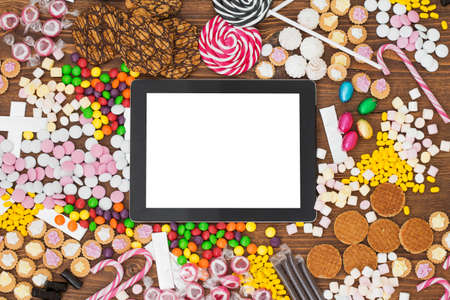 Blank tablet computer and candy