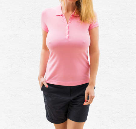 Sexy woman in blank pink polo shirt, mockup for your own design