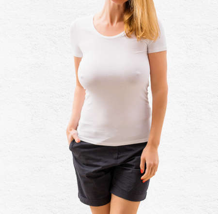 Sexy woman in white empty T-shirt template Stock fotó