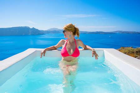 Woman relaxing in outdoor bathtub