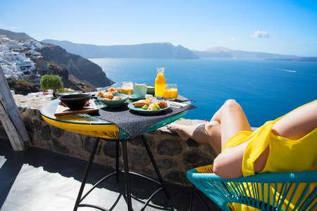 Woman enjoying breakfast on terrace Stockfoto