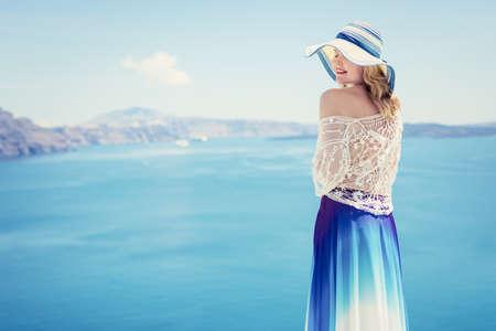 Woman enjoying the beauty of sea