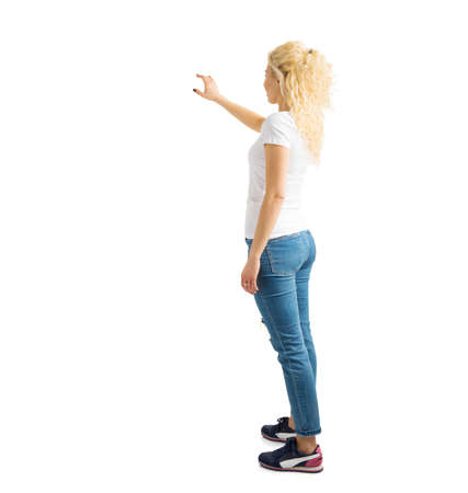 Woman standing and pointing at white background 스톡 콘텐츠
