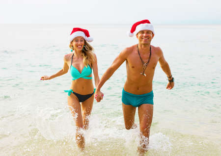Happy couple enjoying winter holidays on the beach