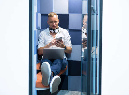 Man using silent pod room in modern coworking office Stock Photo - 91044718