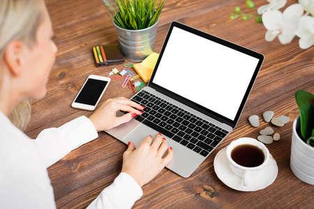 Creative woman working on laptop Standard-Bild